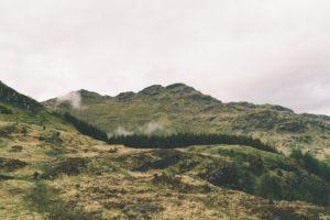 green mountain under cloudy sky