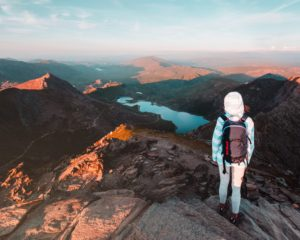 person standing on steeped mountain