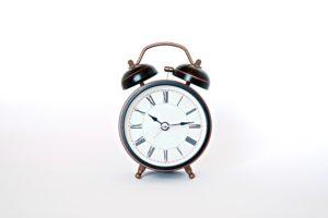 black and white round analog alarm clock